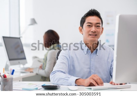 Portrait of Asian businessman working on computer in the office