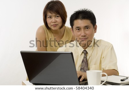 Portrait of Asian businesspeople working together - stock photo