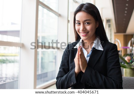 Portrait of asian businesswoman greeting with thai style.