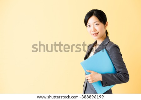 portrait of asian businesswoman isolated on yellow background