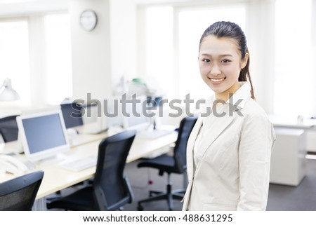 portrait of asian businesswoman relaxing in the office