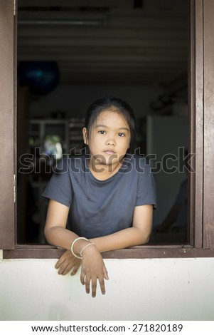 Portrait of Asian children with the windows