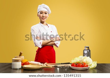 Portrait of Asian cooks, crossed her arms