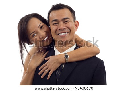 Portrait of Asian couple hugging and smiling isolated over white background - stock photo