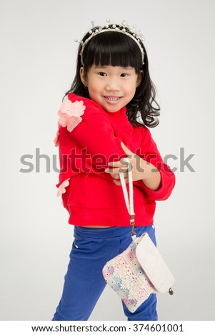 Portrait of asian cute girl with smile face on gray background