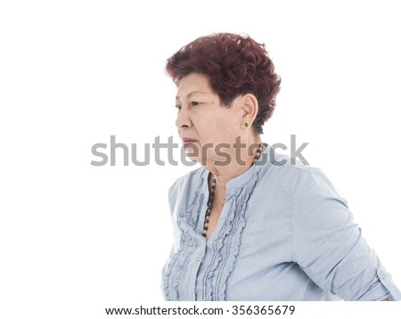Portrait of Asian elderly woman, isolated over white background.