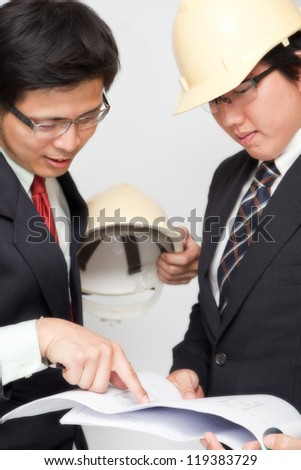 Portrait of Asian Engineers discussed about their project. - stock photo