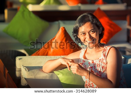 Portrait of Asian Ethnic Adult Female Feeling Happy and Smiling - stock photo