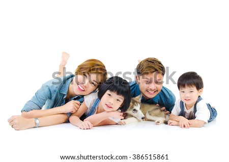 Portrait of asian family and their pet on white background