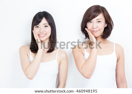 portrait of asian family daughter and mother isolated on white background