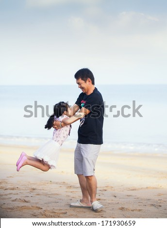 Portrait Of Asian Family walking On the Beach - stock photo