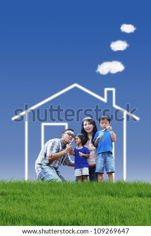 Portrait of asian family with dream house playing bubble outdoor