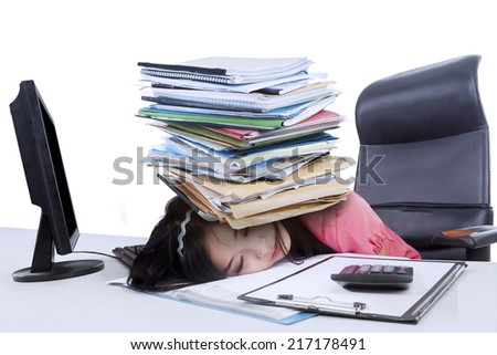 Portrait of asian female accountant with a pile of paperwork over her head - stock photo