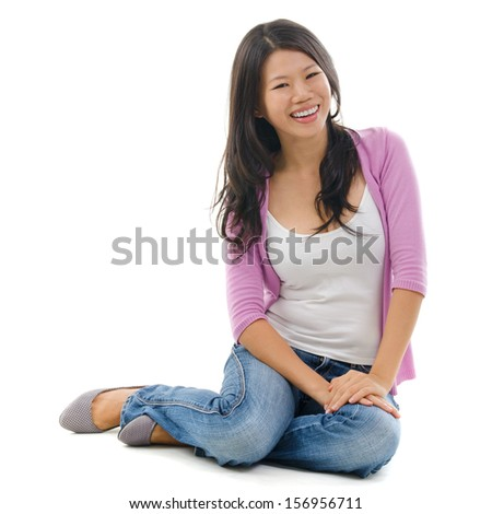 Portrait of Asian female smiling and sitting isolated over white background. - stock photo