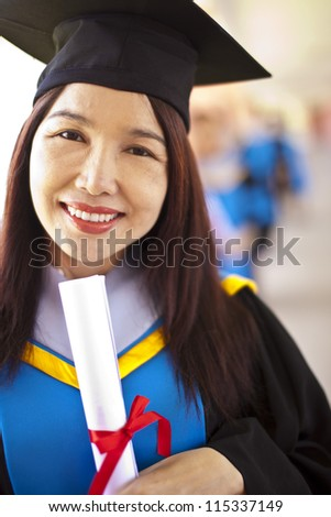 Portrait of Asian graduating student. - stock photo