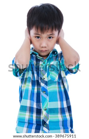 Portrait of asian handsome boy covering his ear. Isolated on white background. Negative human emotion, facial expression feeling reaction. Studio shot. - stock photo