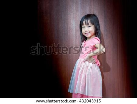 Portrait of Asian happy little girl , akimbo - stock photo