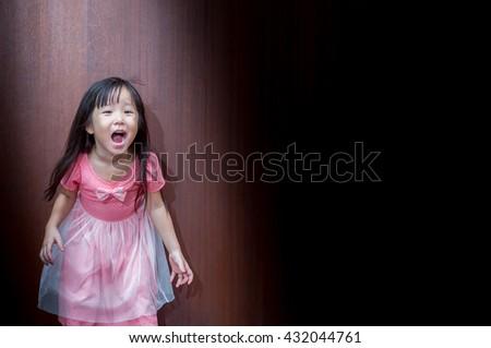 Portrait of Asian happy little girl , shouts - stock photo