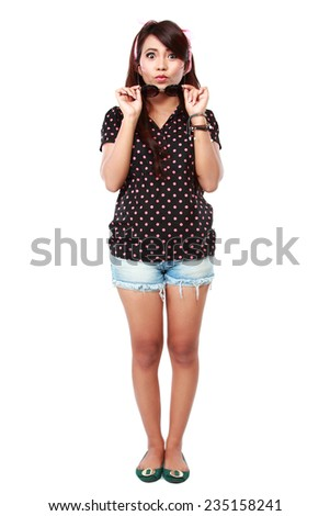 Portrait of asian happy young girl remove glasses and looking at camera - stock photo