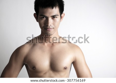 Portrait of Asian male model shirtless - stock photo