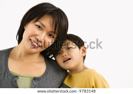 Portrait of Asian mother and young son leaning on eachother.
