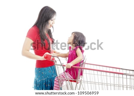 Portrait of asian mother talking and laughing to her daughter on the shopping cart. isolated on white - stock photo