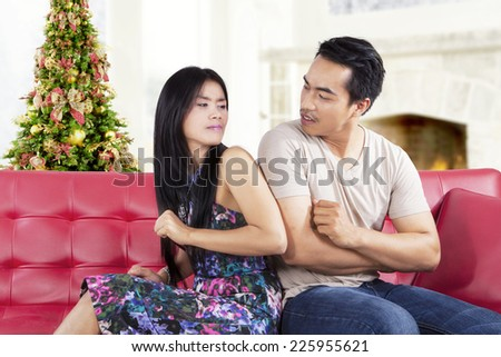 Portrait of asian people quarreling at home with christmas tree background - stock photo