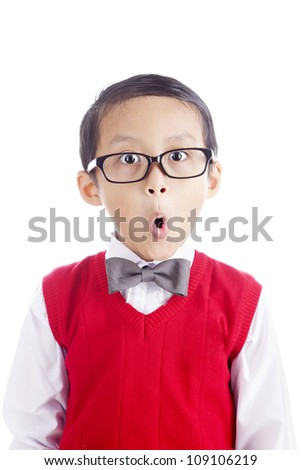 Portrait of asian schoolboy with funny expression face. shot in studio isolated on white - stock photo