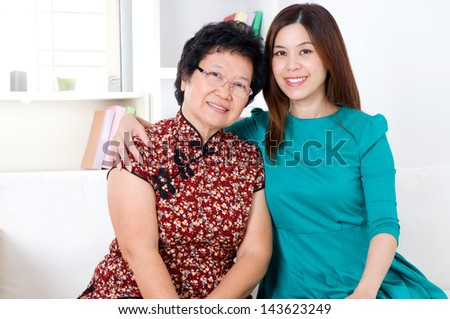 Portrait of asian senior woman and daughter - stock photo