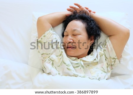 Portrait of asian senior woman sleeping on the bed