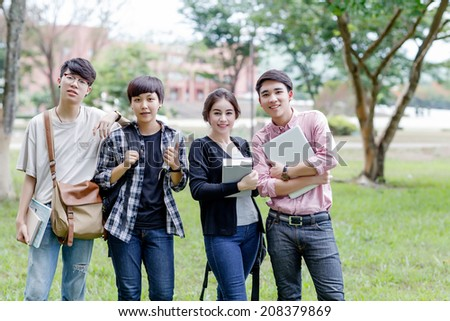 Portrait of asian students smiling in university - stock photo