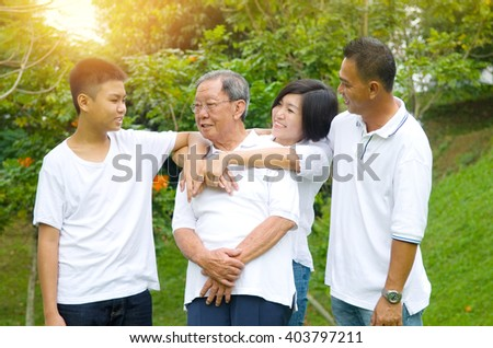 Portrait Of Asian three Generation Chinese Family Relaxing at outdoor park