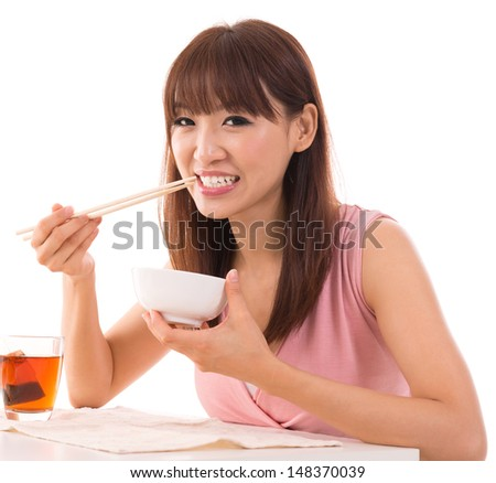 Portrait of Asian woman eat rice isolated on white background. Asian female model.