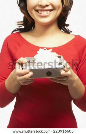 Portrait of Asian woman holding gift - stock photo