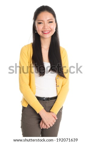 Portrait of Asian woman in yellow blouse isolated on white background. Casual Asian girl with long black hair smiling looking happy. - stock photo