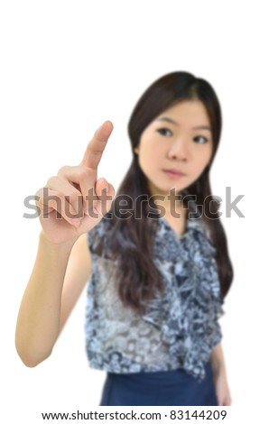 Portrait of asian woman pointing on white background - stock photo