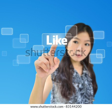 Portrait of asian woman pressing like button on a flow of buttons - stock photo