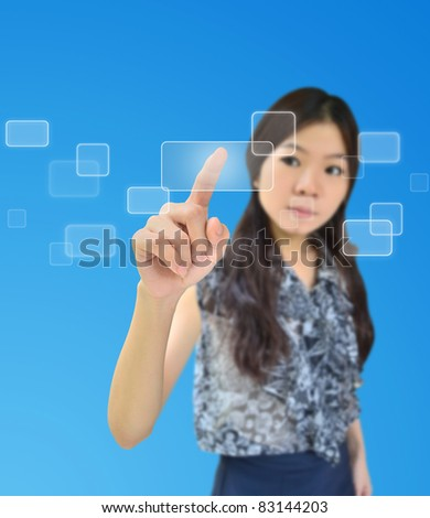 Portrait of asian woman pressing on a flow of buttons - stock photo