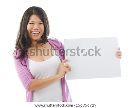 Portrait of Asian woman smiling and showing a blank card board isolated over white background. - stock photo