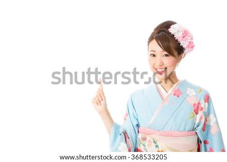 portrait of asian woman wearing kimono isolated on white background - stock photo