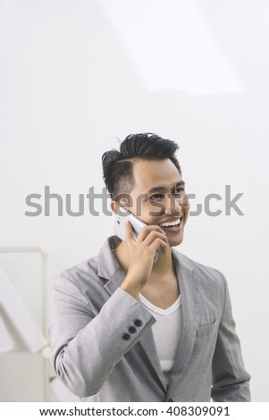 Portrait of asian young businessman talking to the phone