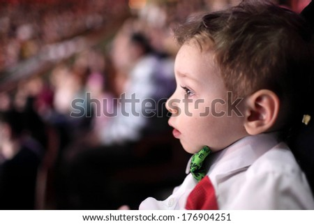 Portrait of astonished boy at a circus - stock photo