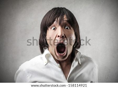 portrait of astonished Japanese - stock photo