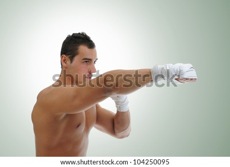 portrait of athletic boxer. on green background - stock photo