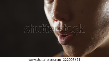 Portrait of athletic woman sweating taking a break from workout - stock photo
