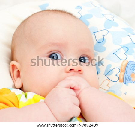 Portrait of attentive  cute little baby girl - stock photo