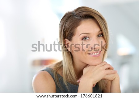Portrait of attractive and smiling businesswoman - stock photo