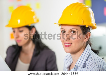 Portrait of attractive architect wearing security helmet. Selective focus - stock photo