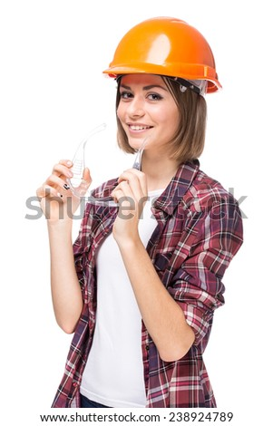 Portrait of attractive architect woman with hard hat, isolated on white background. - stock photo