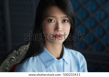 Portrait of Attractive Asian Woman in Restaurant